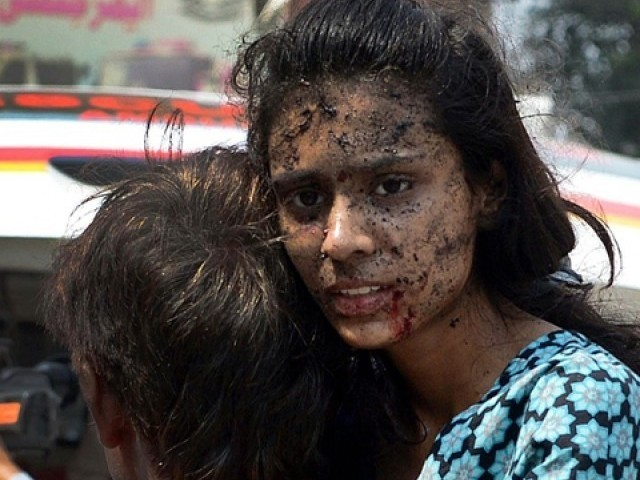 Peshawar Carnage victim looks on in shock and disbelief after the blast at church.