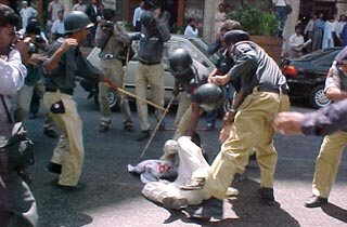 Sindh Police beating a protester in Karachi
